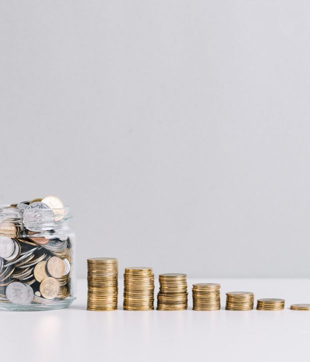 glass-jar-full-money-front-decreasing-stacked-coins-against-white-background